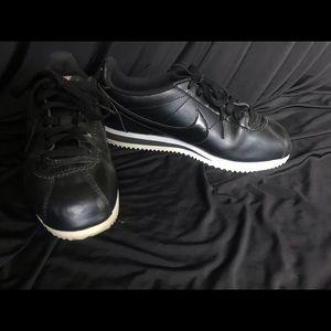 Black on black nike Cortez